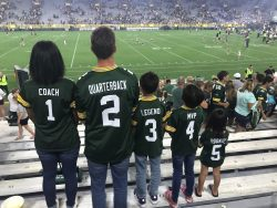family wearing matching jerseys at a Green Bay Packers football game